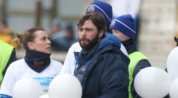 Poignant: Gary Hamilton releases balloons as part of a charity drive on the first anniversary of the death of Philip Millar