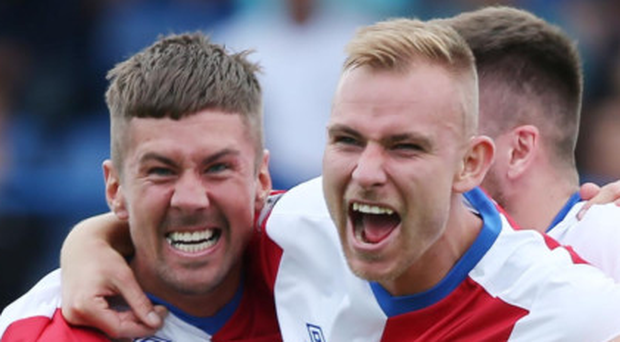 Dream stuff: Daniel Kearns (left) celebrates with Andy Mitchell after scoring Linfield's winner