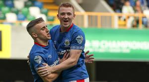 Floodgates open: Shayne Lavery celebrates with Joel Cooper after setting Linfield on their way