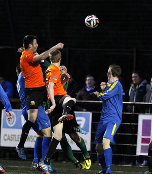 Comeback complete: Eoin Bradley rises highest to nod home Glenavon's late winning goal against Moyola Park