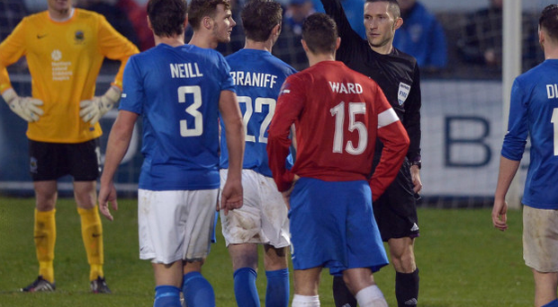 Marching orders: Controversial referee Mervyn Smyth sends off Linfield's Seanan Clucas and Glenavon's Kevin Braniff