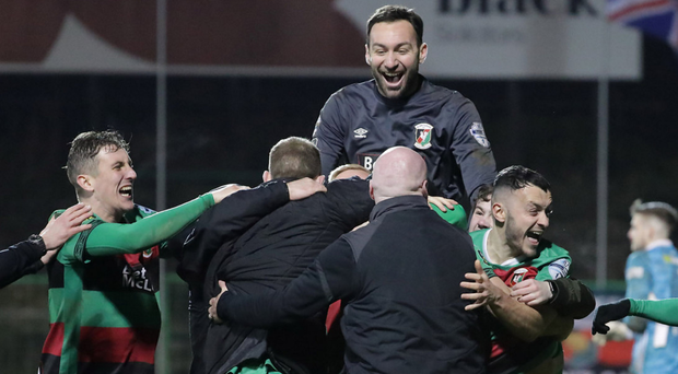 Spot of joy: Jonny Frazer (right) laps up the Glens' penalty glee