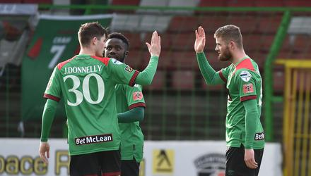 Glentoran's Ruaidhri Donnelly celebrates his winner with brother Jay. Credit: Colm Lenaghan/Pacemaker