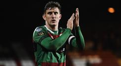 In hand: Glentoran captain Marcus Kane applauds the fans at the end of Saturday's game