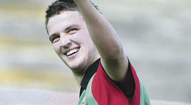 Net hit: Glentoran's Jim O'Hanlon celebrates after scoring from the penalty spot in the first half against Coleraine