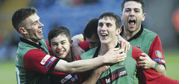 Kevin Bradley, Jordan Stewart, Mark Clarke and Ryan O'Neill surround Glens goalscorer Marcus Kane