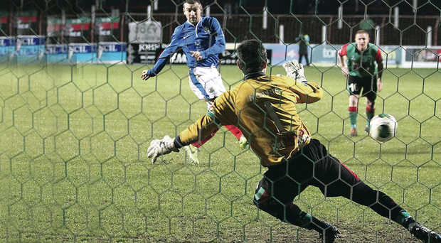 Linfield Matthew Tipton scores a penalty past Glentoran goalkeeper Elliott Morris during Friday night's Danske Bank Premiership 'Big Two' Derby at the Oval