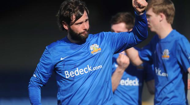 Deal me in: Gary Hamilton salutes the Glenavon fans during Saturday's demolition of Glentoran