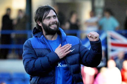Blue at heart: Glenavon boss Gary Hamilton celebrates the club's top three finish at the final whistle