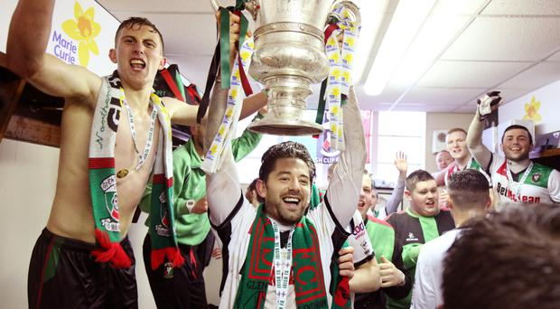 Glory boys: Curtis Allen celebrates with the Irish Cup after conquering Portadown in the final at The Oval
