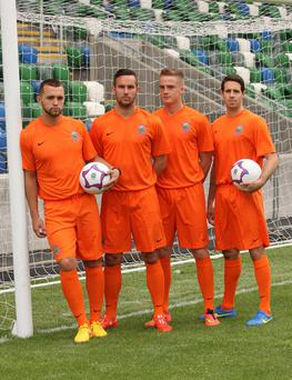 The future's bright: Chris Hegarty, Andy Waterworth, Aaron Burns and Sean Ward show off Linfield's new away kit