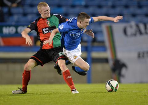 Stalemate: Glentoran's Steven Gordon and Glenavon's James Singleton tussle for supremacy
