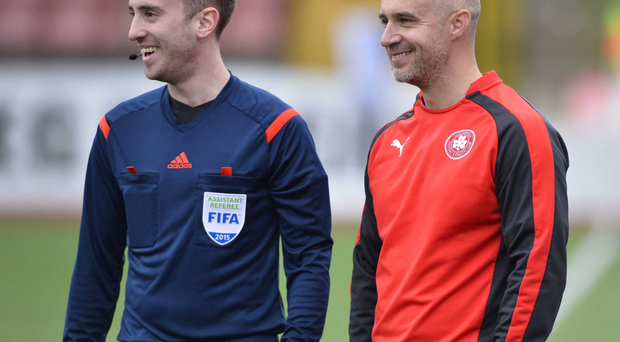 Official business: Gerard Lyttle (right) has a laugh with assistant referee Stephen Bell during Saturday's game at Solitude