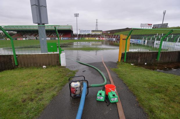 Dampener: pumps are attempting to clear The Oval pitch of water but Chairman Stephen Henderson fears the worst