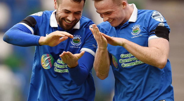 All smiles: Ross Gaynor and Aaron Burns celebrate after combining to down Big Two rivals Glentoran at Windsor Park