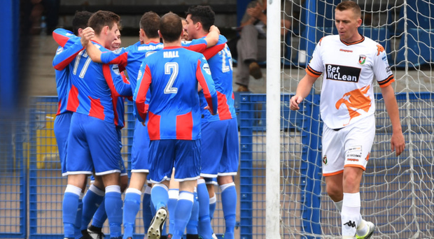 Ard luck: Glentoran defender Jay Magee feels the pain on Saturday as Ards coast to a 2-0 victory