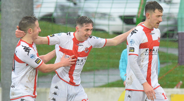 Hitting their stride: Gavin Whyte (centre) takes the acclaim after putting Crusaders 2-0 up against Glentoran