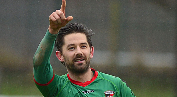 No bother Darren: Glentoran's Curtis Allen has helped to fire Linfield fan Darren Jenkins to the top of the charts.