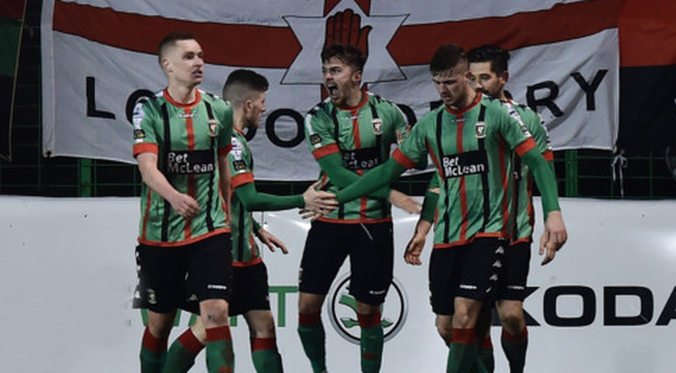 Roaring success: Robbie McDaid shows his delight after his shot hit Matthew Clarke and beat Roy Carroll for Glentoran's winner