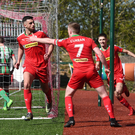 Net buster: Joe Gormley sets off in celebration after striking Cliftonville's late winner
