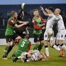 Shoving match: Referee Andris Treimanis attempts to restore order following Marcus Kane's foul on Paul Heatley