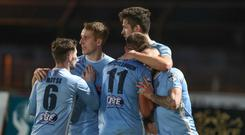 In the bag: Adam Lecky is mobbed after putting the seal on United's success