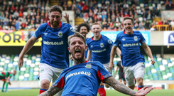 Slide rule: Kirk Millar soaks up the adulation of the crowd after his decisive late strike