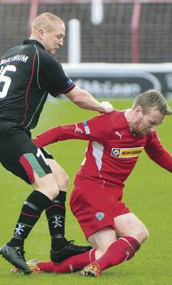 Off day: Referee Mervyn Smyth has defended his decision to dismiss Stephen McAlorum for this challenge on Chris Curran