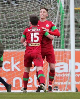 Smile high: Ryan Curran celebrates his goal with Michael McCrudden