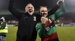 Glory days: Glentoran assistant boss Paul Millar and midfielder Hrvoje Plum celebrate the big Boxing Day win over Linfield