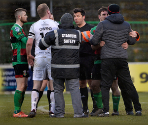 Raised tempers: Crues skipper Jordan Owens and manager Stephen Baxter remonstrate with referee Andrew Davey after the game