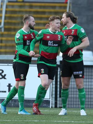 Great start: Keith Cowan (right) takes the acclaim after his debut goal for Glentoran