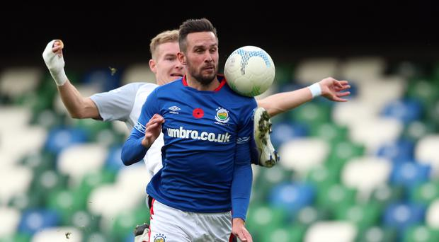 Foot race: Andy Waterworth gets ahead of Carrick defender Chris Rodgers