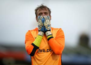 So close: Linfield goalkeeper Roy Carroll after getting a hand to the Cork City penalty at Turner's Cross last night