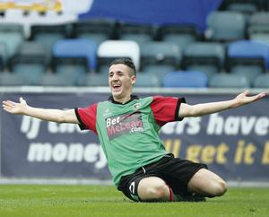 Glentoran youngster Danny McKee celebrates after scoring the opening goal against Linfield