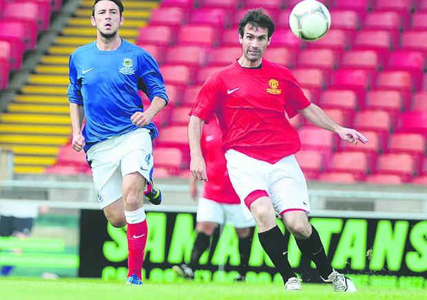 Linfield's Michael Gault pictured in action with Manchester United's Keith Gillespie