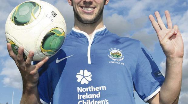 Treble joy: Andy Waterworth with the match ball after his hat-trick for Linfield against Ballymena United