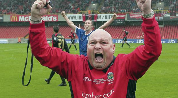 David Jeffrey celebrates clinching the 2011 Irish Cup, one of the 31 trophies he won as Linfield manager
