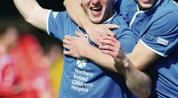 Goal-den boy: Michael Carvill grabbed the winner for Linfield to help boss Warren Feeney begin his managerial career at Linfield with a victory