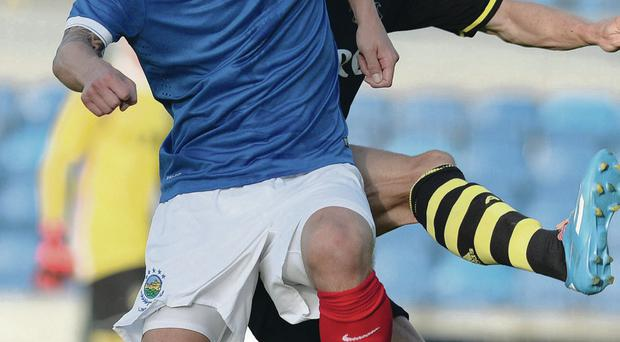 Finish the job: Peter Thompson in action against AIK Solna on his 400th appearance for the Blues