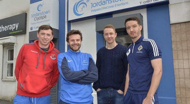 Refreshed: Crusaders' Nathan Hanley (second from left) is joined by team-mates Billy Joe Burns, Timmy Adamson and Josh Robinson to help launch Jordanstown Cryospa