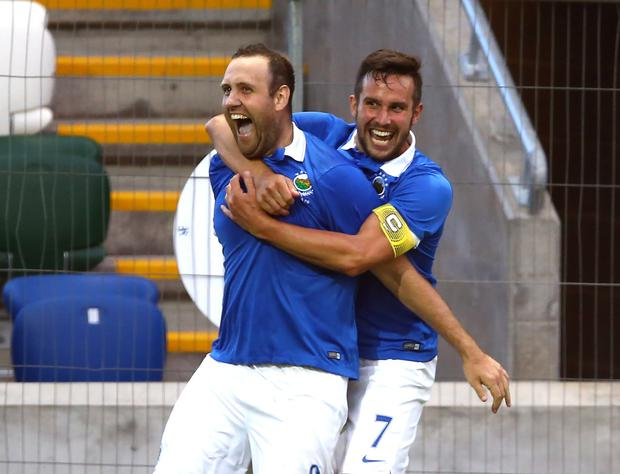 Double trouble: New boy Guy Bates celebrates his goal with captain Andy Waterworth who opened the scoring at Windsor Park