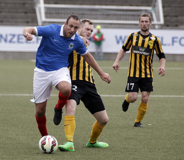 On the charge: Linfield goalscorer Guy Bates takes on the Runavik defence