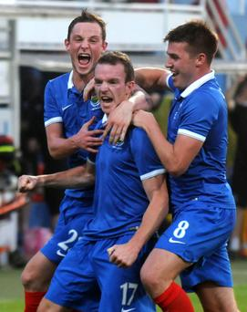 Take that: Linfield midfielder David Kee (centre) celebrates his stunning strike in Slovakia