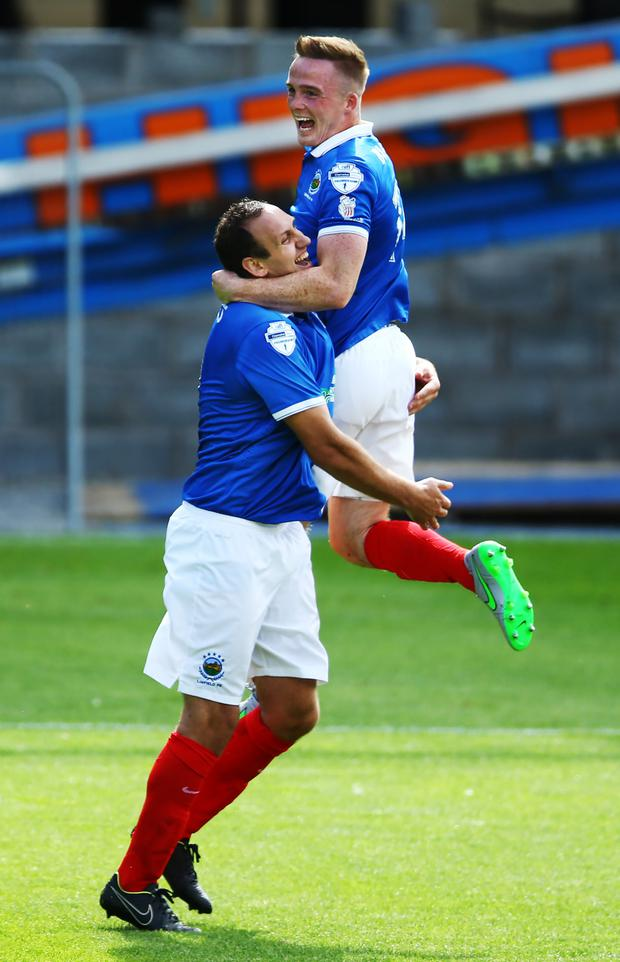 Flying high: Aaron Burns celebrates scoring against Dungannon Swifts, his fourth goal in three games
