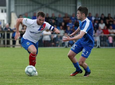 Proud day: Linfield midfielder Jamie Mulgrew (left) will be honoured with a testimonial when Rangers visit Windsor Park tomorrow