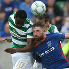 Head game: Mark Stafford battles for possession with Moussa Dembele