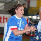 Linfield Ladies' Sarah Venney lifts the league trophy last season