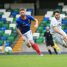 In the running: Linfield ace Mark Stafford is wary of high-flying Coleraine as the Blues aim to shatter Oran Kearney and co's unbeaten record