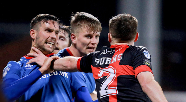 Firm belief: Andy Waterworth clashes with Crusaders ace Billy Joe Burns on Wednesday night